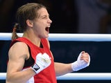 Katie Taylor of Ireland celebrates defeating Sofya Ochigava of Russia to win gold during the women's boxing Lightweight final of the 2012 London Olympic Games at the ExCel Arena August 9, 2012