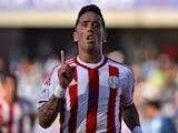 Paraguay's forward Lucas Barrios celebrates after scoring against Uruguay during their 2015 Copa America football championship match, in La Serena, on June 20, 2015