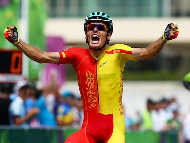 Luis Leon Sanchez Gil of Spain celebrates as he crosses the line to win gold during the Men's Cycling Road Race on day nine of the Baku 2015 European Games at Freedom Square on June 21, 2015