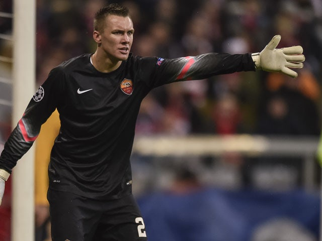 Roma's goalkeeper from Poland Lukasz Skorupski reacts during the UEFA Champions League Group E second-leg football match FC Bayern Munich vs AS Roma in Munich, southern Germany, on November 5, 2014