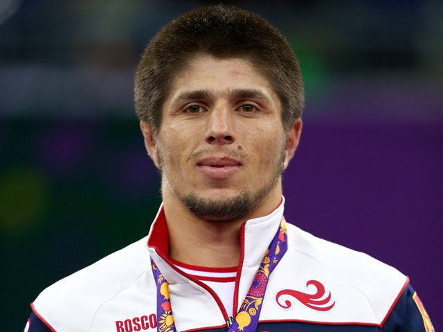 Gold medalist Magomedrasul Gazimagomedov of Russia stands on the podium during the medal ceremony for the Men's Wrestling 70kg freestyle on day six of the Baku 2015 European Games at the Heydar Aliyev Arena on June 18, 2015