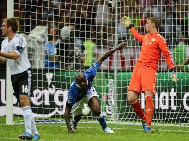 Italian forward Mario Balotelli (C) celebrates after scoring during the Euro 2012 football championships semi-final match Germany vs Italy on June 28, 2012