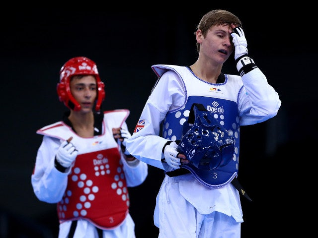 Max Cater of Great Britain turns away in disappointment after losing to Belgium's Si Mohamed Ketbi in the quarter-final of the men's -58kg taekwondo tournament at the European Games in Baku