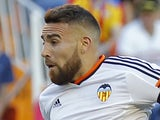 Valencia's Argentinian defender Nicolas Otamendi jumps to shoot during the Spanish league football match Valencia CF vs RC Celta de Vigo at the Mestalla stadium in Valencia on May 17, 2015