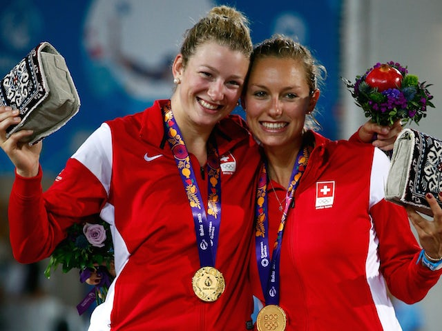 Gold medalists Nicole Eiholzer and Nina Betschart of Switzerland stand on the podium for the medal ceremony after the Women's Beach Volleyball finals during day eight of the Baku 2015 European Games at the Beach Arena on June 20, 2015