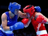 Savannah Marshall of Great Britain (red) and Nouchka Fontijn of the Netherlands (blue compete in the Women's Middle Weight (69-75kg) Round of 16 Bout during day seven of the Baku 2015 European Games at the Crystal Hall on June 19, 2015