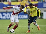 Peru's forward Paolo Guerrero (L) and Colombia's defender Jeison Murillo vie for the ball during their 2015 Copa America football championship match, in Temuco, Chile, on June 21, 2015