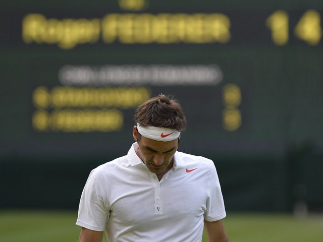 Switzerland's Roger Federer returns to the baseline after a point against Ukraine's Sergiy Stakhovsky during their second round men's singles match on day three of the 2013 Wimbledon Championships tennis tournament at the All England Club in Wimbledon, so