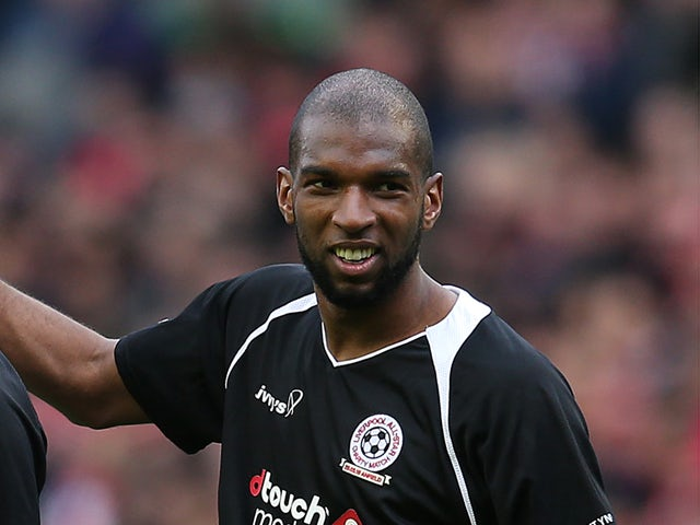 Ryan Babel (R) of the Gerrard XI at full time following the Liverpool All-Star Charity match at Anfield on March 29, 2015