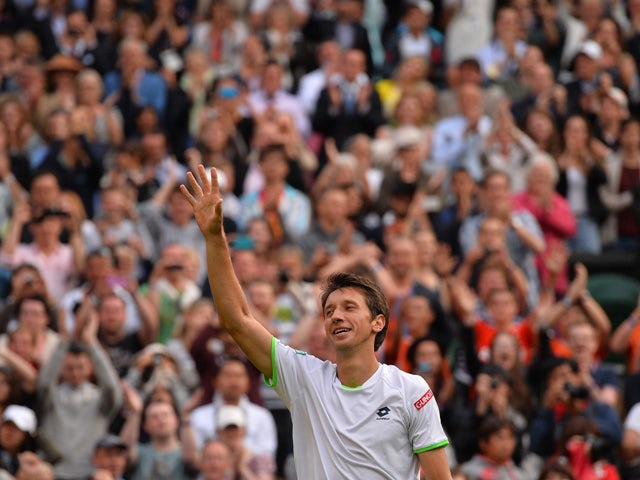 Ukraine's Sergiy Stakhovsky celebrates beating Switzerland's Roger Federer in their second round men's singles match on day three of the 2013 Wimbledon Championships tennis tournament at the All England Club in Wimbledon, southwest London, on June 26, 201