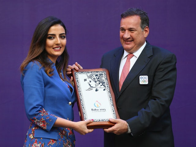 Konul Nurullayeva (L) the Chef de Mission of Azerbaijan is presented with a plaque by Spyros Capralos (R) the Coordination Chairman of the European Games during the arrival of the torch for the athletes welcome ceremony in the athletes village ahead of th