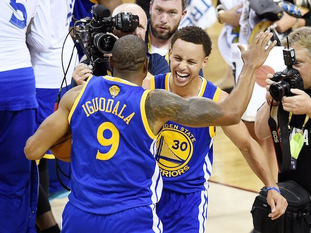 Andre Iguodala and Stephen Curry of the Golden State Warriors celebrate winning the NBA title on June 16, 2015