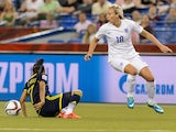 Toni Duggan #18 of England looses the ball to Carolina Arias #17 of Colombia during the 2015 FIFA Women's World Cup Group F match at Olympic Stadium on June 17, 2015