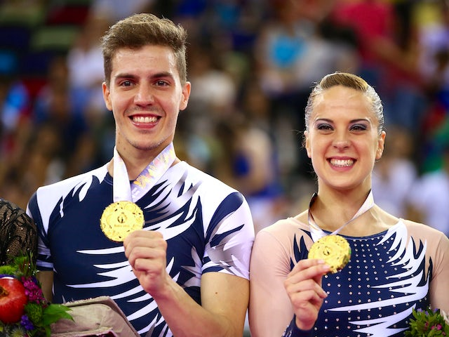 Gold medalists Vicente Lli Lloris and Sara Moreno Lopez of Spain celebrate on the podium during the medal ceremony for the Aerobic Gymnastics Mixed Pairs final on day nine of the Baku 2015 European Games at the National Gymnastics Arena on June 21, 2015