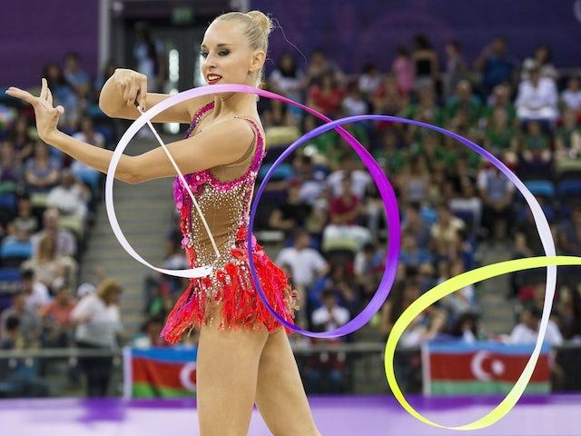 Russian's Yana Kudryavtseva competes in the women's gymnastic rhythmic individual apparatus final at the 2015 European Games in Baku on June 21, 2015