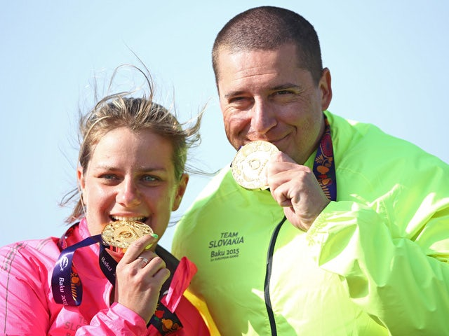 Gold medalists Zuzana Rehak Stefecekova and Erik Varga of Slovakia celebrate with the medals won in the Mixed Team Trap final against Russia during day six of the Baku 2015 European Games at the Baku Shooting Centre on June 18, 2015