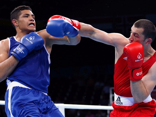 Abdulkadir Abdullayev of Azerbaijan (red) and Paul Omba Biongolo of France compete in the Men's Heavy Weight (91kg) Quarterfinal bout during day eleven of the Baku 2015 European Games at the Crystal Hall on June 23, 2015
