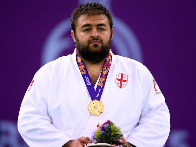 Gold medalist Adam Okruashvili of Georgia stands on the podium during the medal ceremony for the Men's Judo +100kg on day fifteen of the Baku 2015 European Games at Heydar Aliyev Arena on June 27, 2015