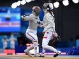 Aliya Itzkowitz of Great Britain (L) and Martyna Watora of Poland compete in the Women's Fencing Individual Sabre round of 32 match during day thirteen of the Baku 2015 European Games at the Crystal Hall on June 25, 2015