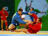Kanan Gasimov of Azerbaijan (blue) and Alsim Chernoskulov (red) compete during the Men's Sambo -90kg semi finals during day ten of the Baku 2015 European Games at the Heydar Aliyev Arena on June 22, 2015