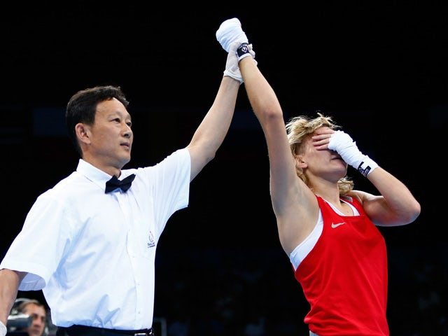 Anastasiia Beliakova (red) reacts as she is awarded the victory over Sandy Ryan of Great Britain after the Women's Light Welterweight 60-64kg bout during day thirteen of the Baku 2015 European Games at the Crystal Hall on June 25, 2015