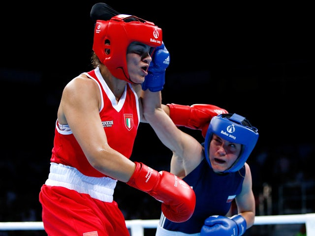Valentina Alberti of Italy (red) and Aneta Rygielska of Poland (blue) compete in the Women's Boxing Light Welterweight (60-64kg) Semi Final during day thirteen of the Baku 2015 European Games at the Crystal Hall on June 25, 2015