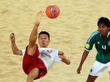 Angelo Schirinzi of Switzerland (L) attempts an overhead kick Francisco Cati Balderrama of Mexico during their Beach Soccer Intercotinental Cup match at Dubai's Jumeira beach on November 22, 2011