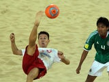 Angelo Schirinzi of Switzerland (L) attempts an overhead kick Francisco Cati Balderrama of Mexico during their Beach Soccer Intercotinental Cup match at Dubai's Jumeira beach on November 22, 2011