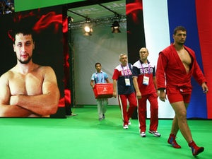Artem Osipenko of Russia enters the arena prior to the Men's Sambo +100kg gold medal final against Vasif Safarbayov of Azerbaijanon day ten of the Baku 2015 European Games at the Heydar Aliyev Arena on June 22, 2015