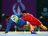 Aymergen Atkunov of Russia (red) and Islam Gasumov of Azerbaijan (blue) compete in the Men's Sambo -57kg Final during day ten of the Baku 2015 European Games at the Heydar Aliyev Arena on June 22, 2015