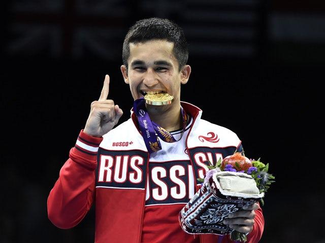 Bakhtovar Nazirov of Russia gestures as he bites his gold medal after winning men's Bantam (56kg) boxing event at the Baku 2015 European Games in Baku June 25, 2015