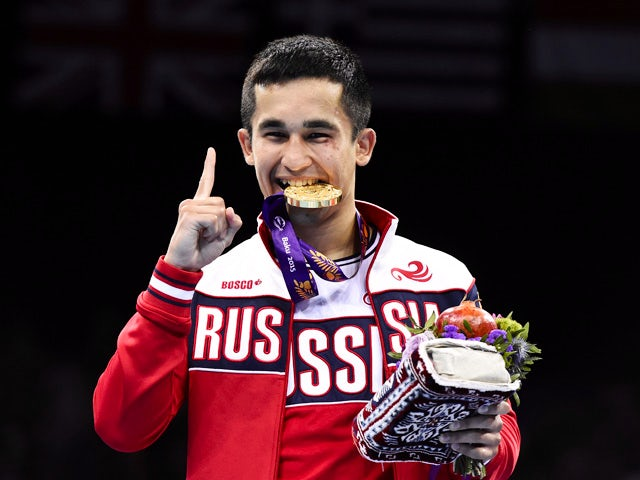 Bakhtovar Nazirov of Russia gestures as he bites his gold medal after winning men's Bantam (56kg) boxing event at the Baku 2015 European Games in Baku June 25, 2015