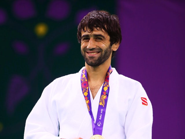 Gold medalist Beslan Mudranov of Russia poses on the medal podium following the Men's Judo -60kg Finals during day thirteen of the Baku 2015 European Games at the Heydar Aliyev Arena on June 25, 2015
