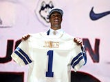 Byron Jones of the Connecticut Huskies holds up a jersey after being picked #27 overall by the Dallas Cowboys during the first round of the 2015 NFL Draft at the Auditorium Theatre of Roosevelt University on April 30, 2015