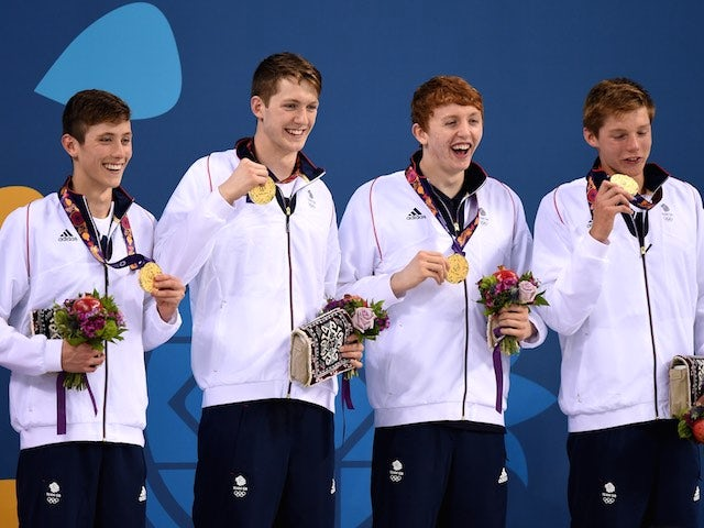 Cameron Kurle, Daniel Speers, Martyn Walton and Duncan Scott celebrate winning gold for Team GB in the men's 4x100m freestyle at the European Games on June 23, 2015