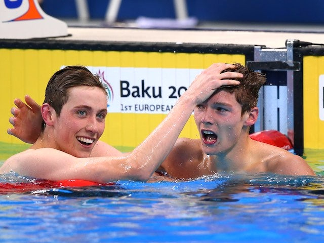 Team GB swimmers Cameron Kurle and Duncan Scott celebrate winning silver and gold respectively in the men's 200m freestyle at the European Games on June 27, 2015