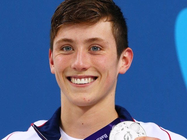 Team GB swimmer Cameron Kurle poses with his silver medal earned during the men's 200m freestyle at the European Games on June 27, 2015