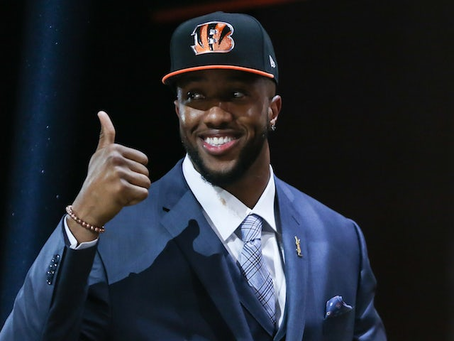 Cedric Ogbuehi of the Texas A&M Aggies walks on stage after being picked #21 overall by the Cincinnati Bengals during the first round of the 2015 NFL Draft at the Auditorium Theatre of Roosevelt University on April 30, 2015