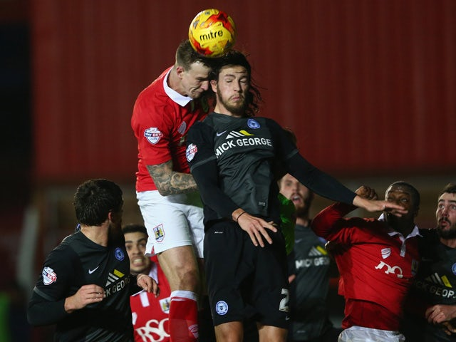 Christian Burgess of Peterborough United challenges during the Sky Bet League One match between Bristol City and Peterborough United at Ashton Gate on February 17, 2015