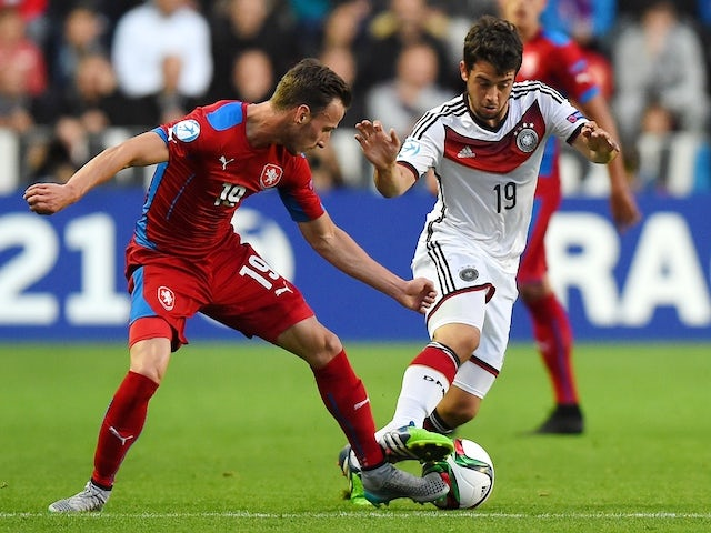Czech Matej Hybs (L) and Germany's Armin Younes fight for a ball during the EURO U21 2015 group A match between Czech Republic and Germany at Eden Arena on June 23, 2015