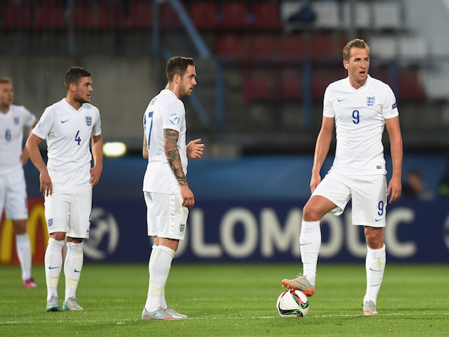 Danny Ings and Harry Kane look dejected after Italy score to make it 2-0 during the UEFA Under21 European Championship match between England and Italy at Andruv Stadium on June 24, 2015