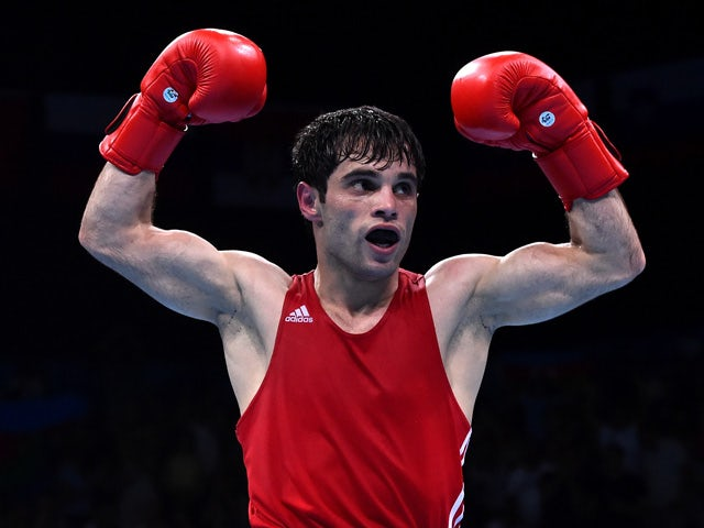 Elvin Mamishzada of Azerbaijan celebrates victory over Vincenzo Picardi of Italy in the Men's Boxing Flyweight (52kg) Final during day fourteen of the Baku 2015 European Games at Crystal Hall on June 26, 2015