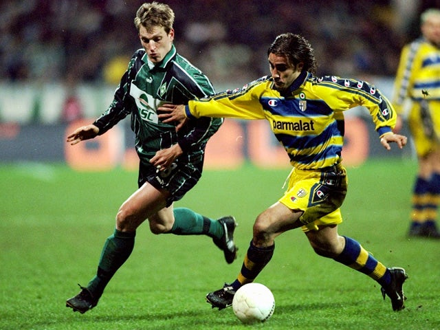 Andreas Herzog of Werder Bremen chases Fabio Cannavaro of Parma during the UEFA Cup fourth round second leg game between Werder Bremen and Parma at the Weserstadion in Bremen, Germany