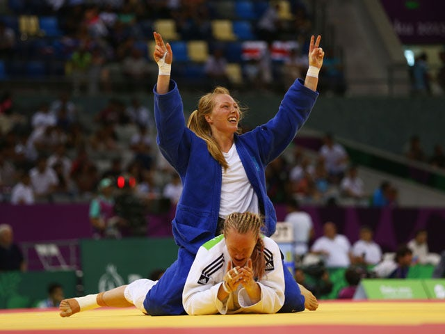 Gemma Howell of Great Britain (white) reacts as Mia Hermansson of Sweden (blue) celebrates victory in the Women's Judo -63kg elimination round of 16 contest during day fourteen of the Baku 2015 European Games at the Heydar Aliyev Arena on June 26, 2015
