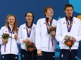 Team GB's mixed relay team Georgia Coates, Darcy Deakin, Martyn Walton and Duncan Scott collect their silver medals at the European Games on June 24, 2015