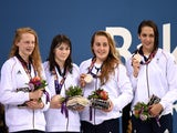 Bronze medalists Georgia Coates, Hannah Featherstone, Madeleine Crompton and Darcy Deakin of Great Britain pose on the medal podium for the Women's Swimming 4 x 100m Freestyle Relay during day eleven of the Baku 2015 European Games at the Baku Aquatics Ce