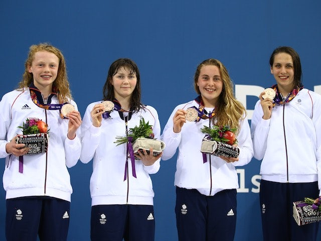 Team GB's Georgia Coates, Hannah Featherstone, Madeleine Crompton and Darcy Deakin hold their bronze medals proudly after the women's 4x100m freestyle at the European Games on June 23, 2015