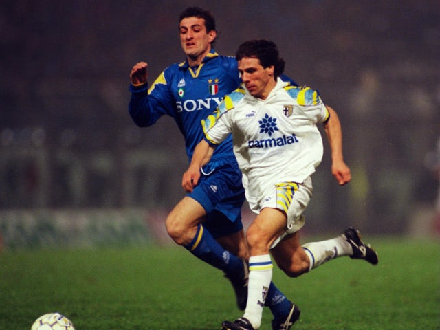 Gianfranco Zola of Parma holds off the challenge of Ciro Ferrara of Juventus during the Serie a league match between Parma and Juventus which was played at the Luigi Ferraris stadium, Parma