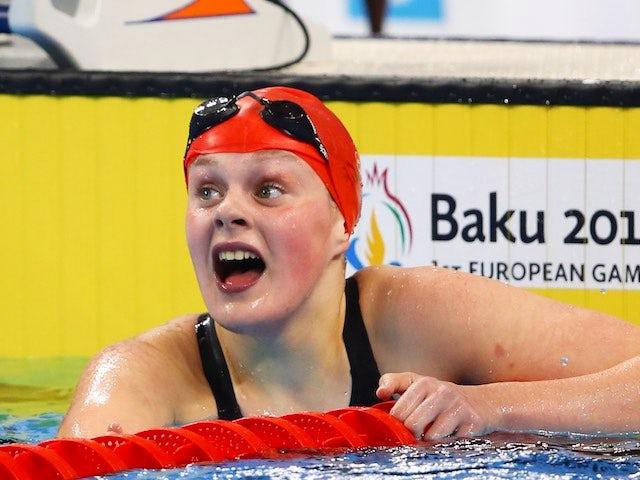 Team GB swimmer Holly Hibbott celebrates winning the women's 800m freestyle at the European Games on June 23, 2015