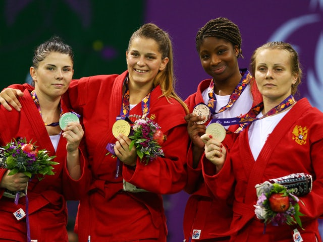Silver medalist Volha Namazava of Belarus, gold medalist Ivana Jandric of Serbia and bronze medalists Celine Conde of France and Olga Zakhartsonva of Russia pose during the medal ceremony for the Women's Sambo -67kg on day ten of the Baku 2015 European Ga
